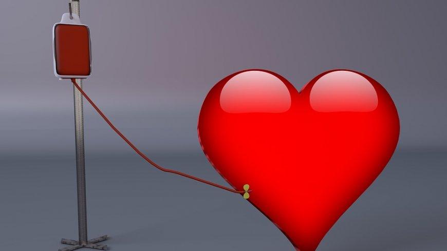 Grafika - czerwone serce oddaje krew - podłączone wenflonem do zbiornika na krew.